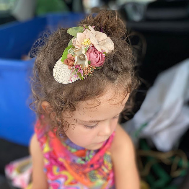 Little Lady Impressions' sweet hair pieces add a little magic.