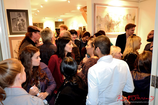 Art crowd at opening of 'Back to Paper' at  Studio W Double You - Street Fashion Sydney