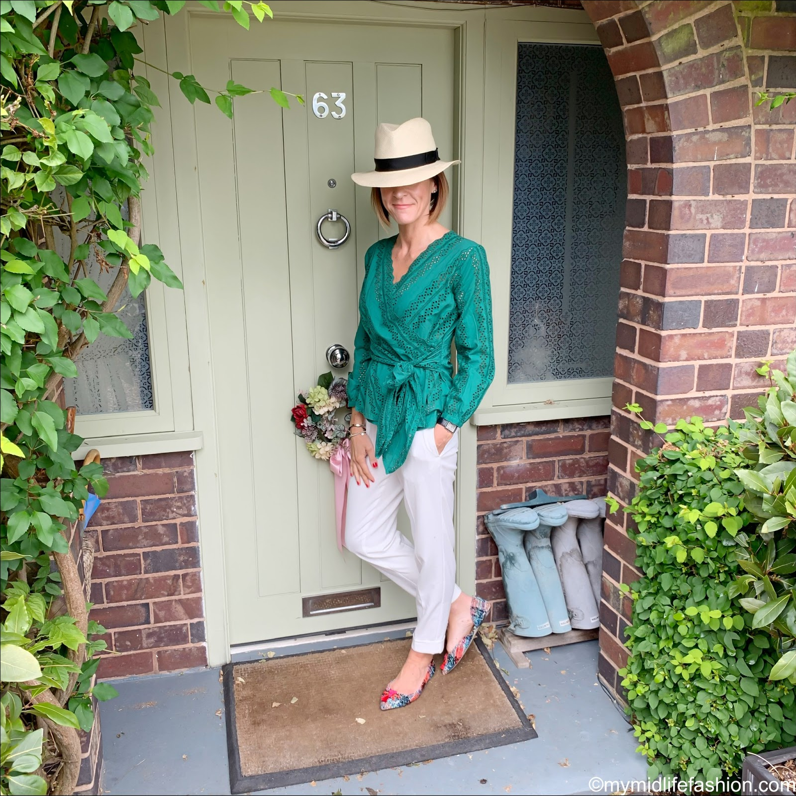 my midlife fashion, marks and Spencer pure cotton embroidered blouse, pleated tapered leg trousers, marks and Spencer luxury Panama hat, j crew tweed tassel flats