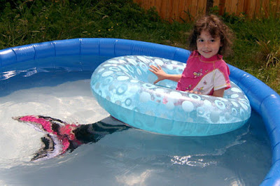 Girl with floatie in pool
