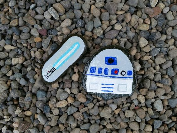 Star wars painted rocks - blue light side light saber and R2D2
