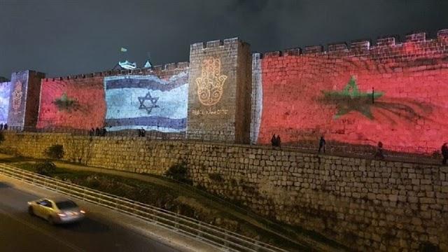 Huge flags of Morocco on the walls of Jerusalem alongside the Israeli flag