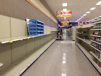 Empty shelves where toilet paper and other paper products should be