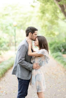 groom kissing fiance on forehead