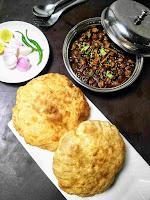 Serving chole bhature