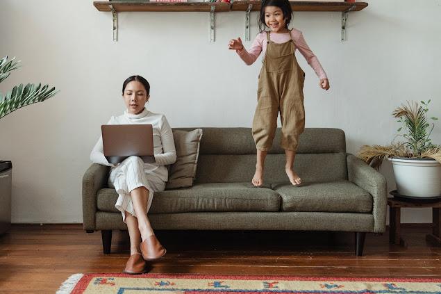 https://www.pexels.com/photo/focused-mother-working-on-laptop-near-disturbing-daughter-4473893/