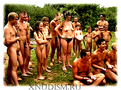Naturist games and fun nudism contests on a nudist beach