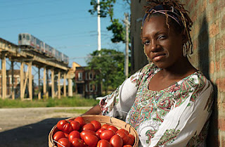 LaDonna Redmond holding a basket of tomatoes
