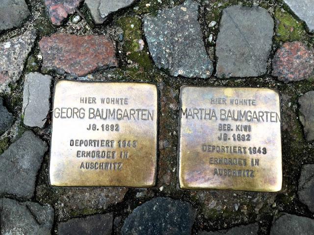 Left: Here lived Georg Baumgarten, born 1892. Deported 1943. Murdered in Auschwitz.  Right: Here lived Martha Baumgarten, nee Kiwi, born 1892. Deported 1943. Murdered in Auschwitz