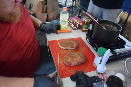 Preparing steaks at a SCA Steak Cookoff at the 2019 Praise The Lard BBQ Contest