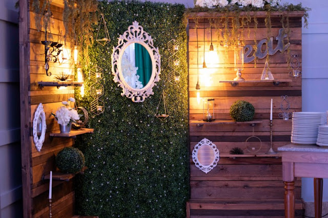 reception decor and hedge wall
