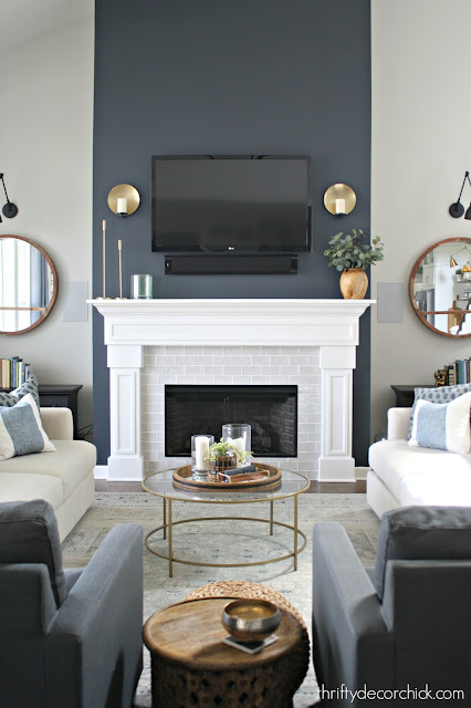 Dark blue/gray paint color on fireplace wall
