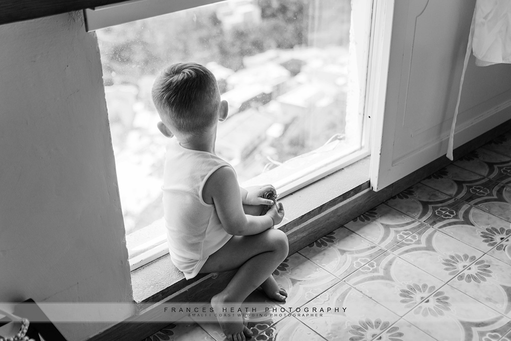 Baby looking out window