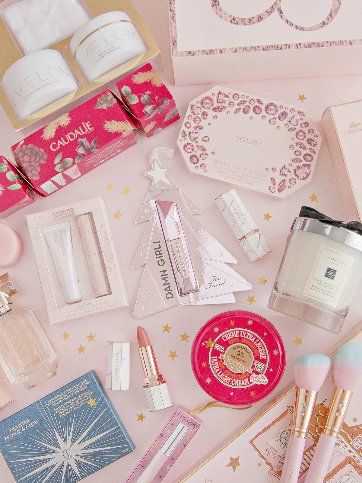 a selection of Christmas beauty products from brands Caudalie, Too Faced, Charlotte Tilbury