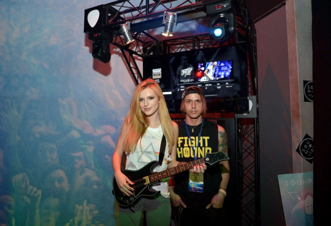 Bella Thorne sports a Pink Floyd top at the Guitar Hero Live Booth at E3 in LA