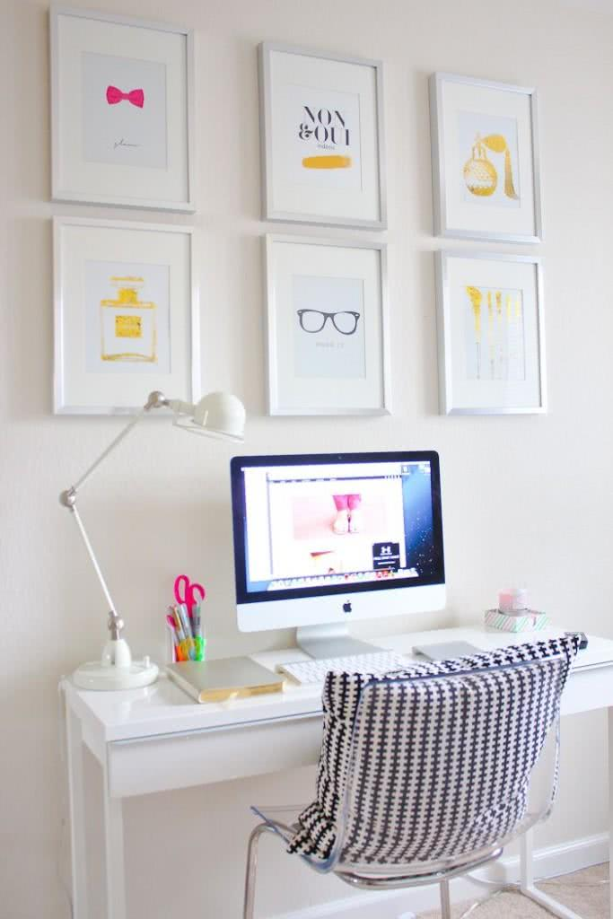 White desk with clean decoration, minimalist paintings