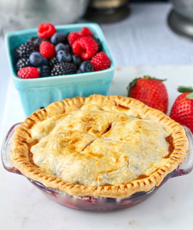 Air fryer mini berry pie in a 6 inch pie pan with a pie crust