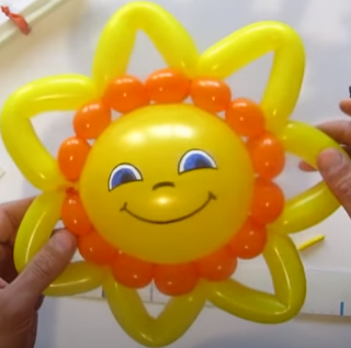 Kleine Sonne aus Luftballons zur Ballondekoration.
