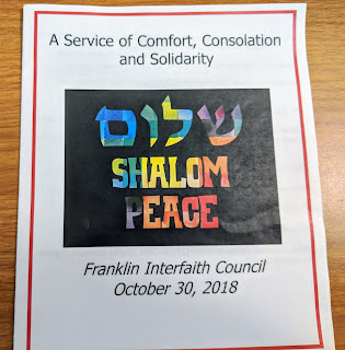 a copy of the Interfaith Service program cover
