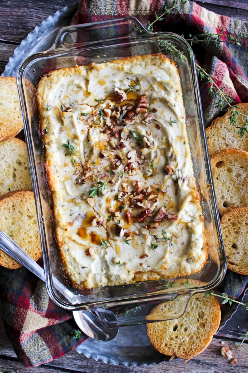 This Baked Goat Cheese Dip made with three kinds of cheese, pecans, honey, and thyme is sure to become your new favorite goat cheese appetizer. It's creamy, cheesy, decadent, and delicious! #goatcheese #appetizer
