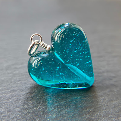 Handmade lampwork glass heart bead by Laura Sparling made with CiM Teal with Dichro