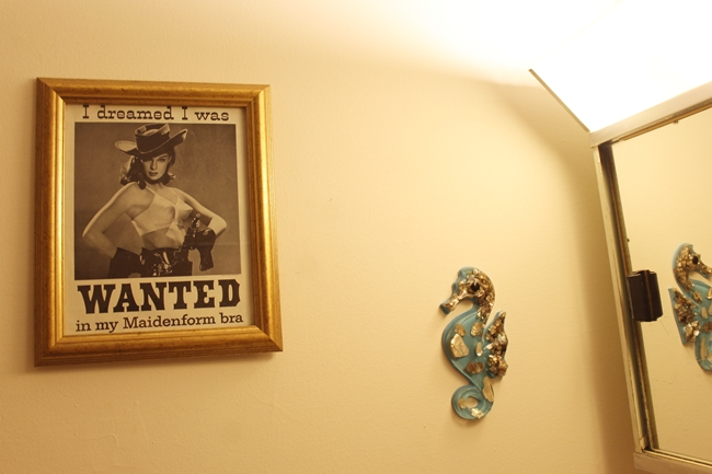vintage I dreamed I was wanted in my maidenform bra ad hanging in vintage bathroom with lucite sea horse wall hanging