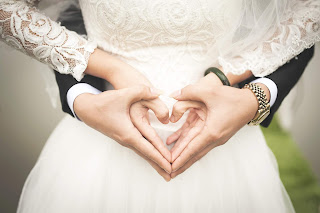 While many aspects of wedding planning can take place months in advance the most important parts of  your wedding day - bride and groom shaping their hands in the love shape - Wedding blog - wedding planners - Weddings by K'Mich - Philadelphia PA