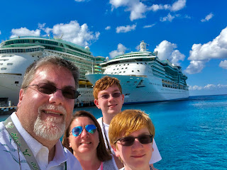 David Brodosi and family on a cruise ship traveling to Cozumel Mexico. Standing buy the ship.