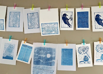 relief prints hanging to dry