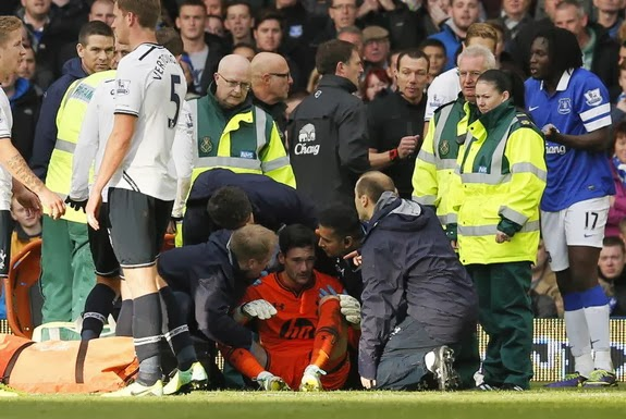 Tottenham goalkeeper Hugo Lloris is attended to by medical staff after being involved in a collision