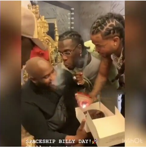 Playful Burna Boy celebrities his friend in a Special Way