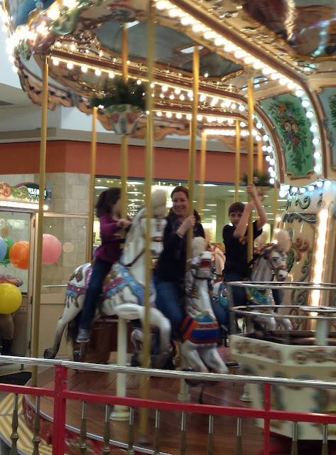 riding a carousel with William and Adelaide