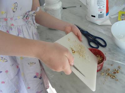 kid chopping pecans