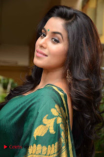 Actress Poorna Latest Pictures in Green Saree at SR Fashion Studio Launch  0007.jpg