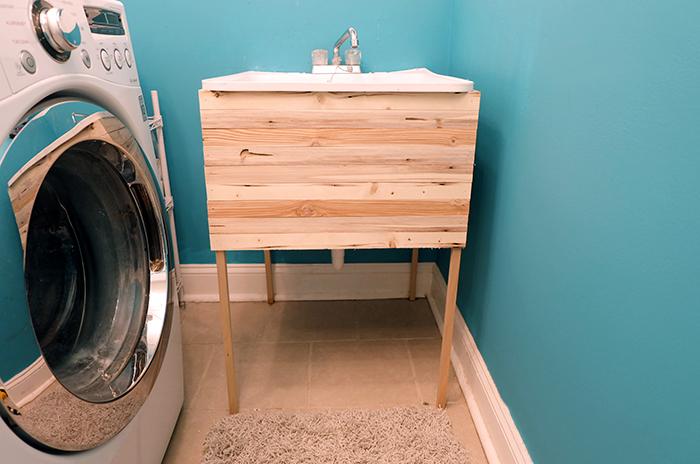 finished laundry utility tub sink wood lath cover