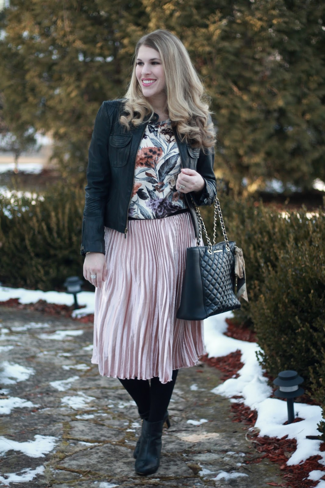 floral velvet top, pink pleated midi skirt, black moto jacket, black booties,