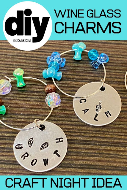 DIY wine glass charms. Looking for a fun make and take craft project for your women's craft night? These DIY wine glass charms are a fun adult craft for every skill level! An easy and fun adult craft night idea for women of all skill levels, this project is perfect for a wine and art night with friends. Pair your event with your favorite bottle of wine and a good time is guaranteed! Learn how to use metal stamping on aluminum tags with jewelry elements and beads to make DIY wine glass charms.