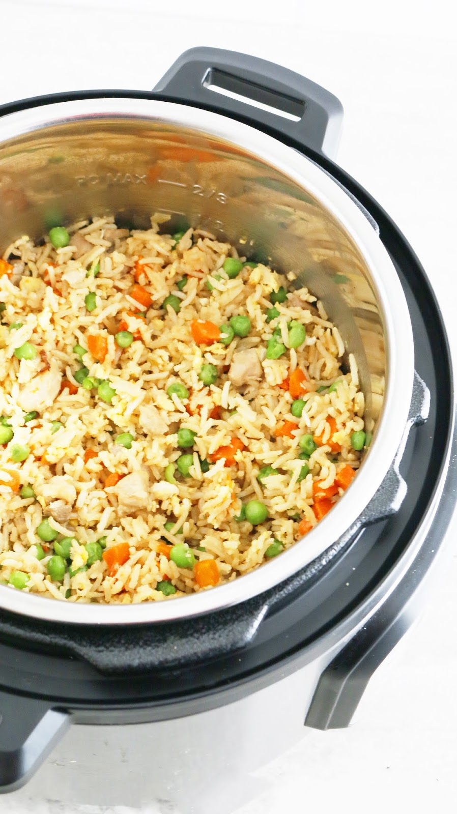 Instant Pot Chicken Fried Rice - Chinese take-out right in your Instant pot. Packed with chunks of tender chicken, scrambled eggs, carrots and peas, this Instant pot chicken fried rice is easier and healthier. No more take-outs!!!