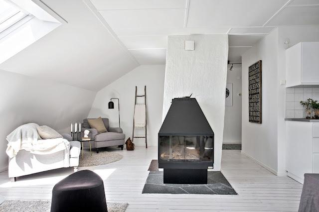 Atmosferă caldă și primitoare într-o mansardă de 67 m²