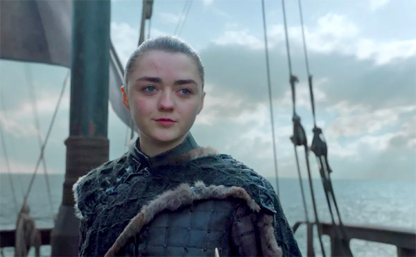 image of Maisie Williams as Arya Stark in Game of Thrones, standing on a sailing ship with a slight smile on her face