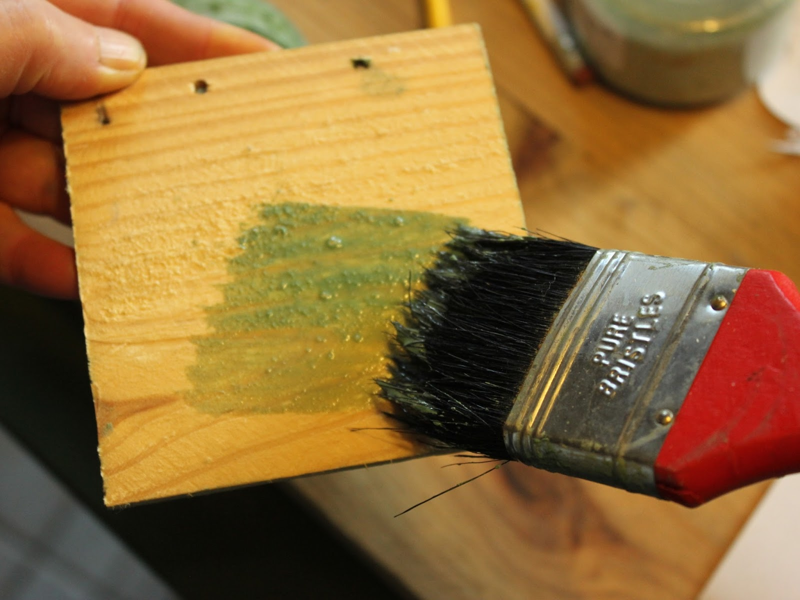 applying varnish to fruit crate wood