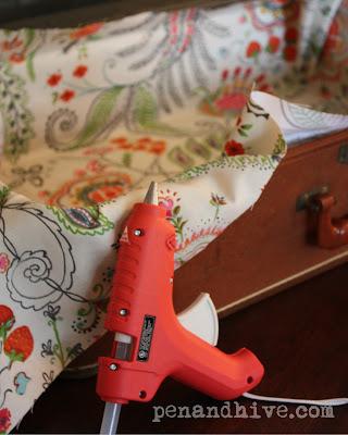 vintage suitcase makeover with hot glue gun