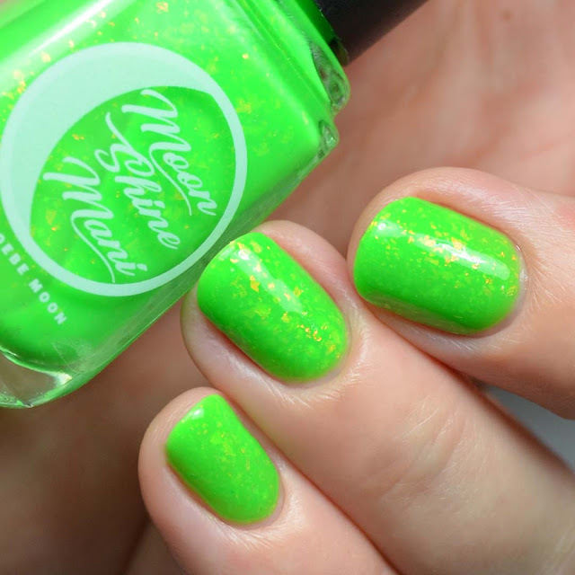 bright green nail polish with flakies swatch