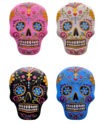 four sugar skull magnets