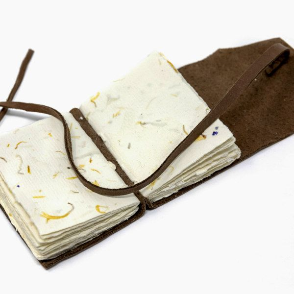 handmade book with signatures made from one sheet of recycled paper with petals
