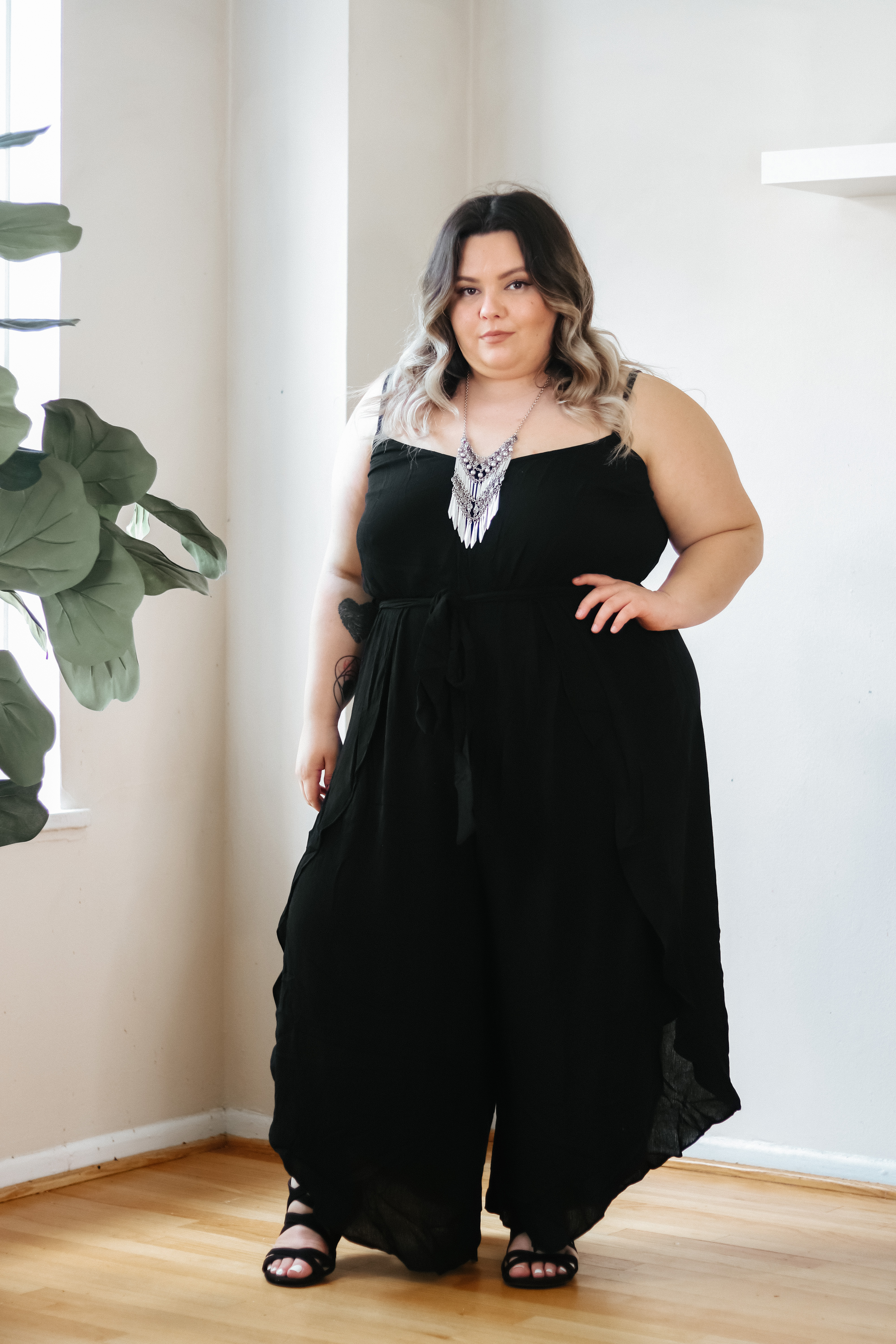 Chicago Plus Size Petite Fashion Blogger, influencer, YouTuber, and model Natalie Craig, of Natalie in the City, reviews CoEdition's jumpsuits.
