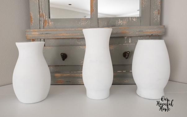 three white painted glass vases