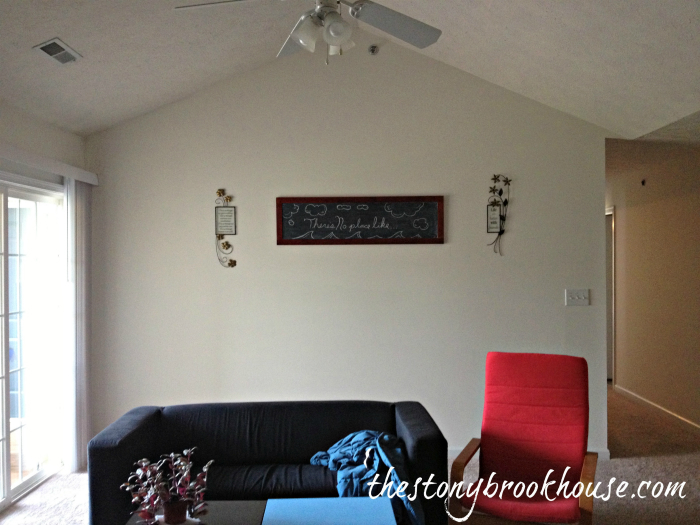 Apt. living room with chalkboard decor