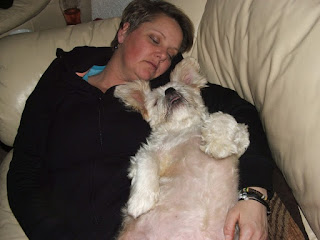 sleeping woman with dog on sofa.jpeg