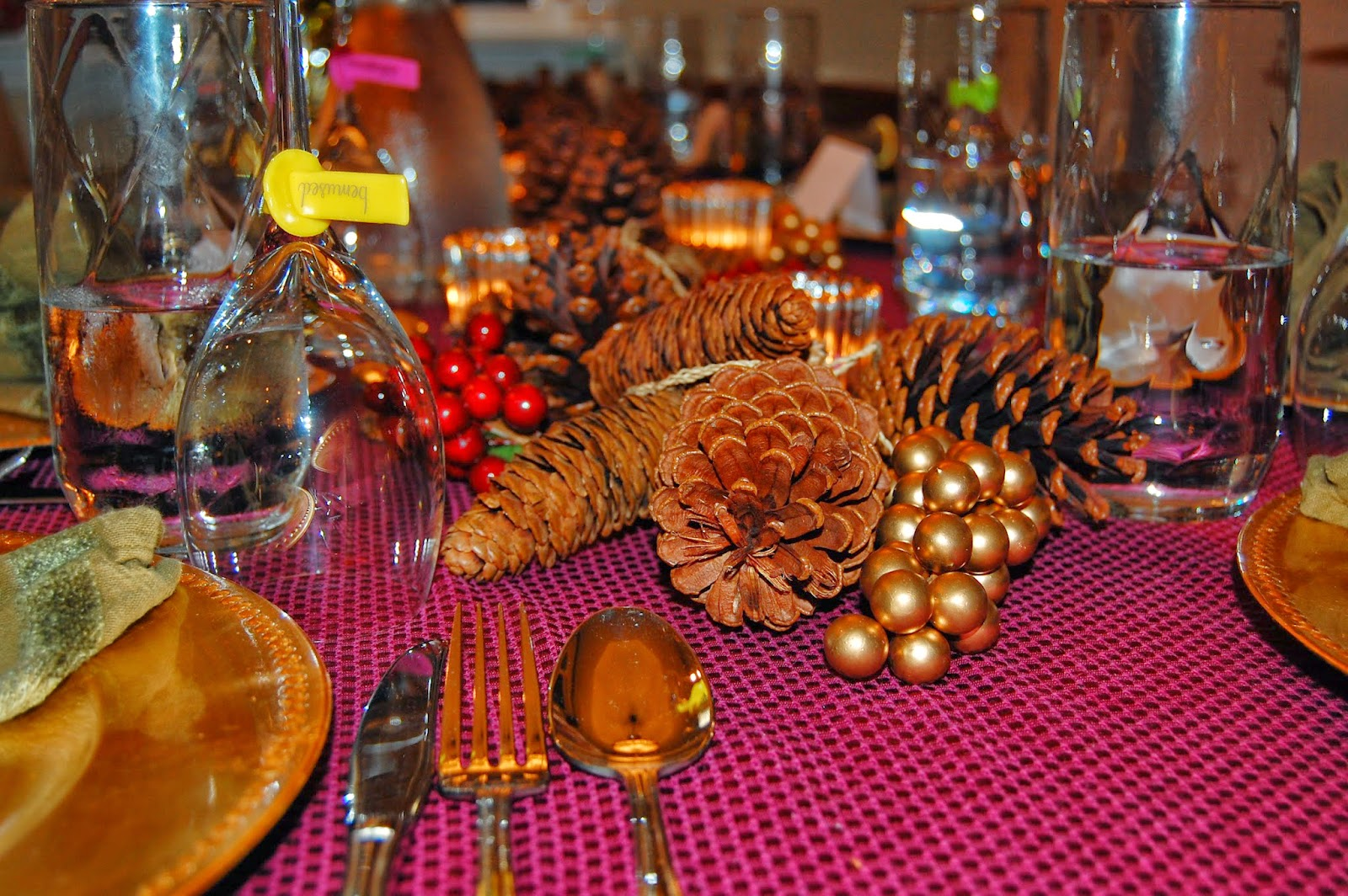 CAD INTERIORS Thanksgiving Christmas table arrangement setting budget decorating design tips pine cones berries candles picks